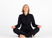 Smiling businesswoman doing yoga exercises